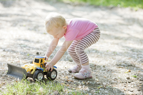little girl playing with little excavator Stock photo © phbcz
