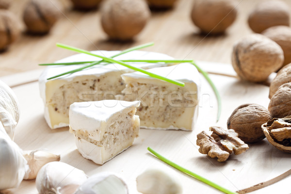 cheese brie filled with cheese mixture of chopped walnuts and ga Stock photo © phbcz