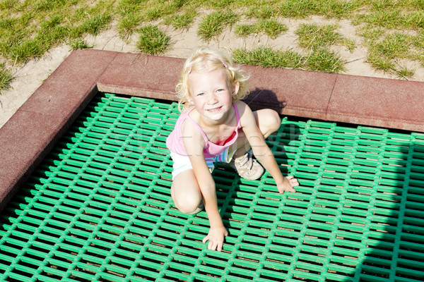 little girl trampoline Stock photo © phbcz