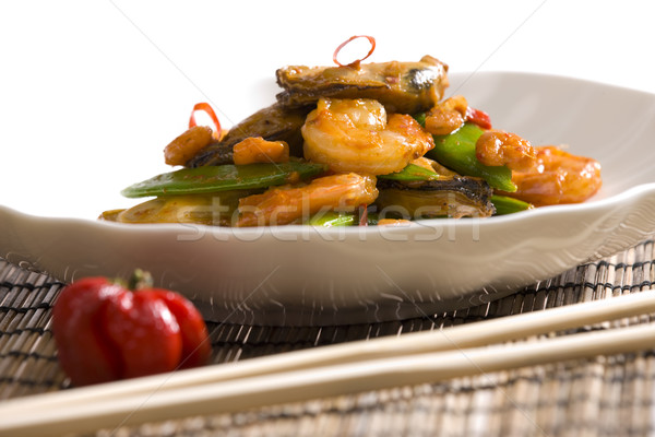 seafood with green pods and red wine Stock photo © phbcz