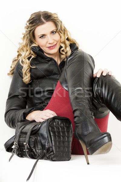 portrait of sitting woman wearing fashionable clothes and boots  Stock photo © phbcz