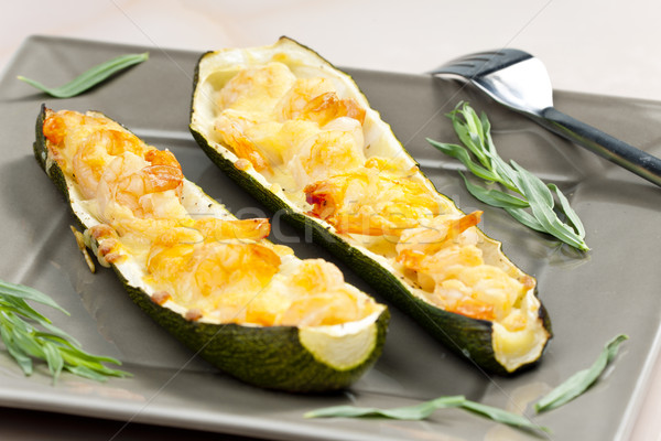 baked prawns on zucchini Stock photo © phbcz