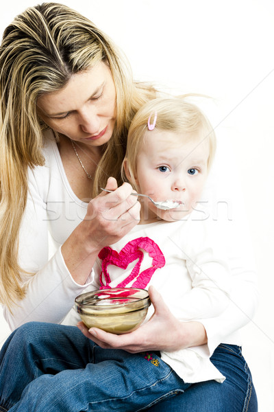 portrait of mother feeding her little daughter Stock photo © phbcz