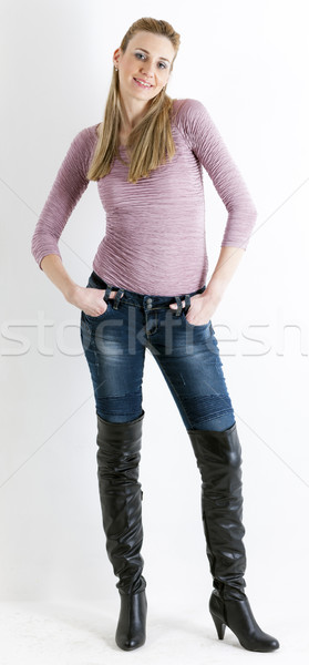 standing woman wearing jeans and black boots Stock photo © phbcz
