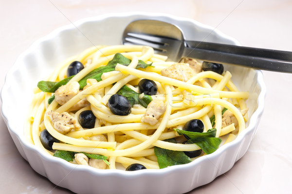 macaroni with chicken meat and black olives on sage Stock photo © phbcz