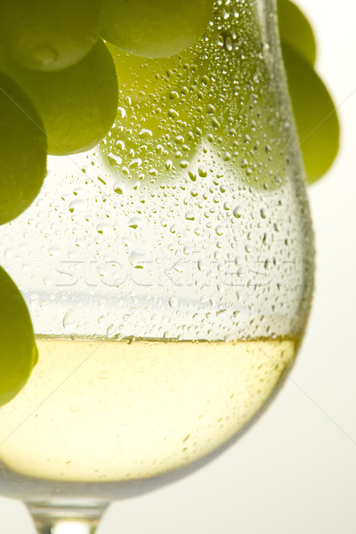 Stock photo: wineglass with white wine and grape