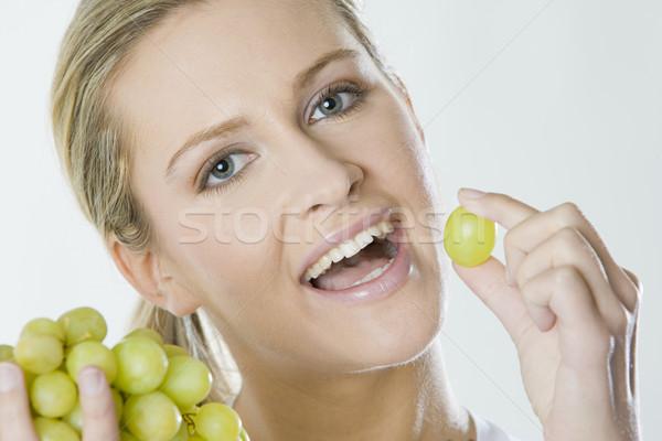 portrait of woman with grape Stock photo © phbcz