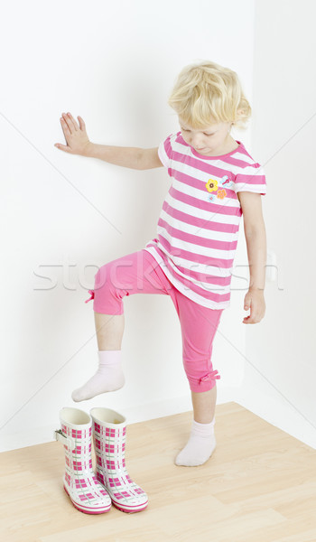 little girl putting on rubber boots Stock photo © phbcz