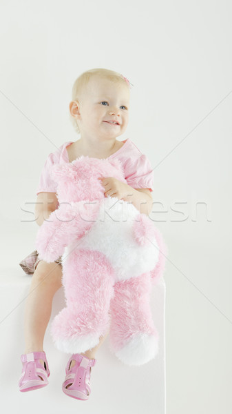 sitting toddler with a teddy bear Stock photo © phbcz