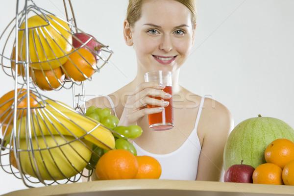 Mulher café da manhã fruto vidro saúde laranja Foto stock © phbcz