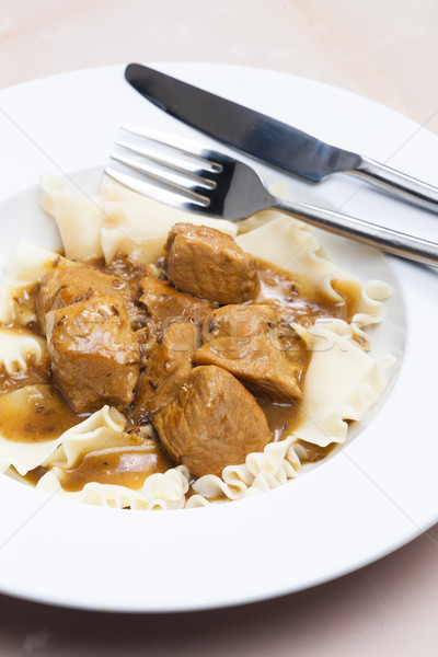 Disznóhús darabok kömény tészta tányér kés Stock fotó © phbcz