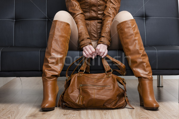 detail of sitting woman in brown clothes holding a handbag Stock photo © phbcz