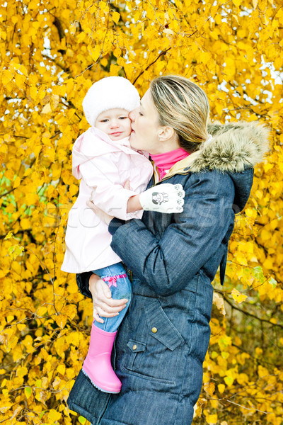 portrait of woman with toddler in autumnal nature Stock photo © phbcz