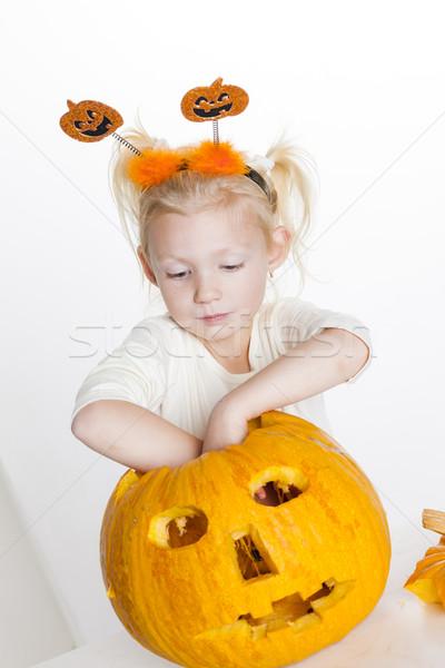 little girl carving pumpkin for Halloween Stock photo © phbcz