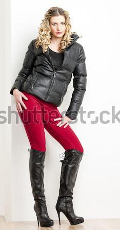 áll fiatal nő visel extravagáns csizma nők Stock fotó © phbcz