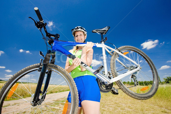 biker carrying her bicycle Stock photo © phbcz