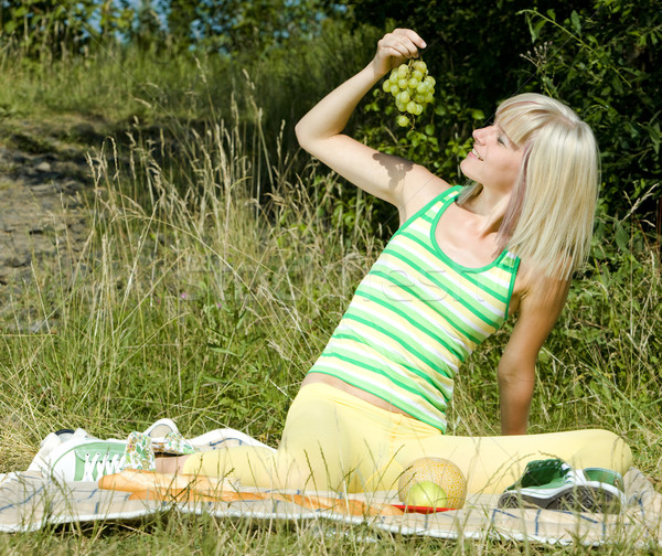woman with grape at a picnic Stock photo © phbcz
