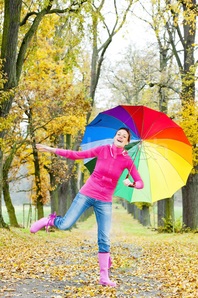 woman with an umbrella in autumnal alley Stock photo © phbcz