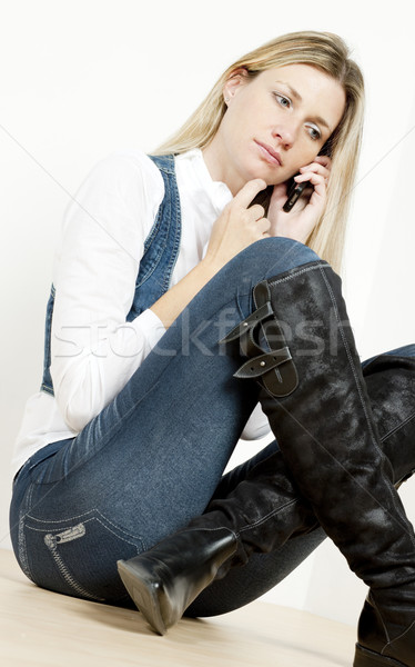 sitting woman with mobile phone Stock photo © phbcz