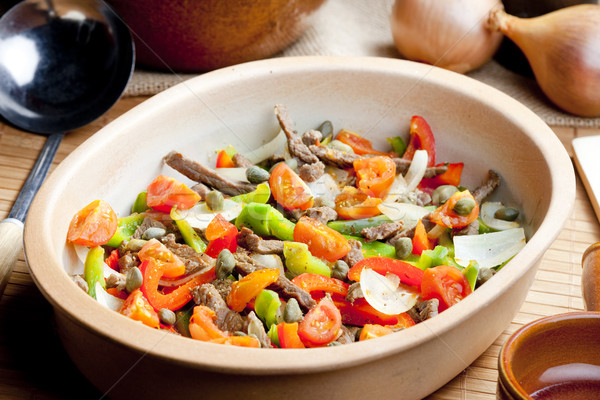 beef meat with peppers, onion and capers Stock photo © phbcz