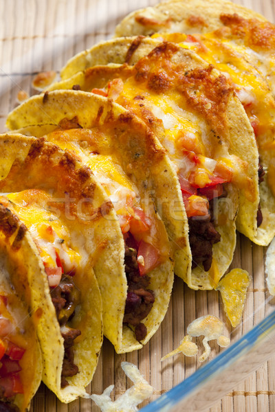baked tacos with tomatoes and minced meat Stock photo © phbcz