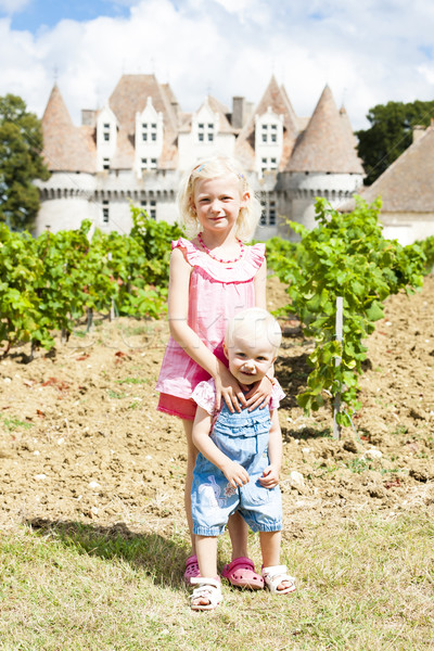 two little girls in front of Monbazillac Castle, Aquitaine, Fran Stock photo © phbcz