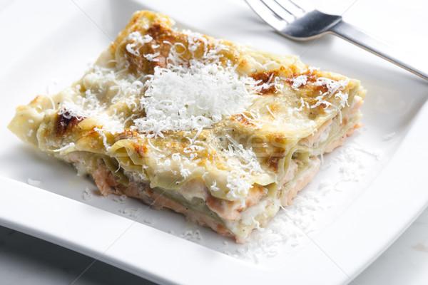 Espinafre lasanha salmão comida queijo garfo Foto stock © phbcz