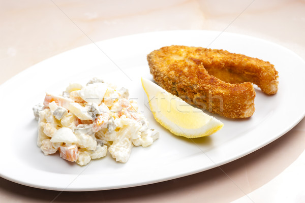 fried carp with potato salad Stock photo © phbcz
