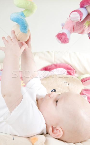 Stock fotó: Kislány · fekszik · játszik · gyerekek · gyermek · lányok