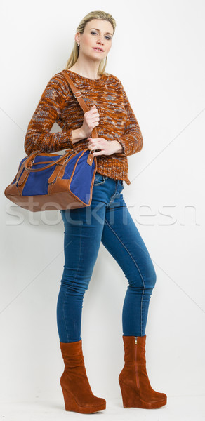 standing woman wearing fashionable platform brown shoes with a h Stock photo © phbcz