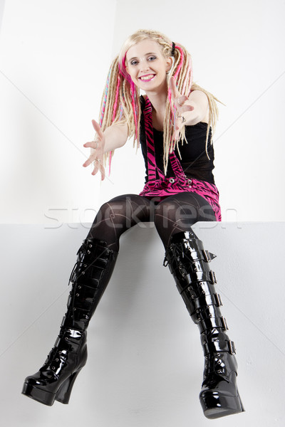 sitting young woman with dreadlocks Stock photo © phbcz