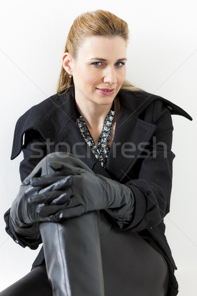portrait of sitting woman wearing black clothes and boots Stock photo © phbcz