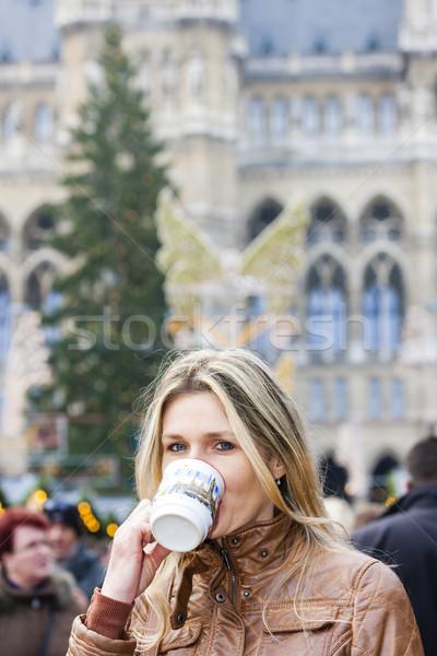 woman drinking hot wine at Christmas market, Vienna, Austria Stock photo © phbcz