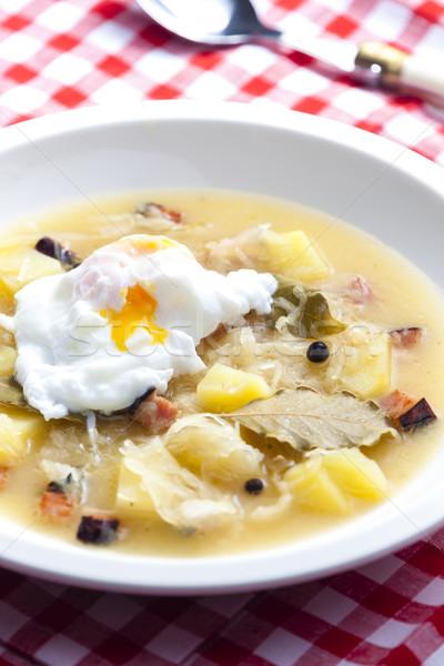 sauerkraut soup with veiled egg Stock photo © phbcz