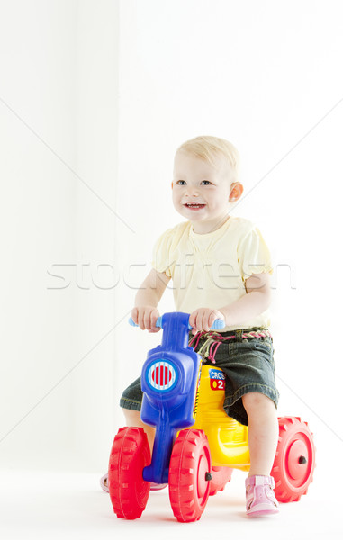 little girl on toy motorcycle Stock photo © phbcz