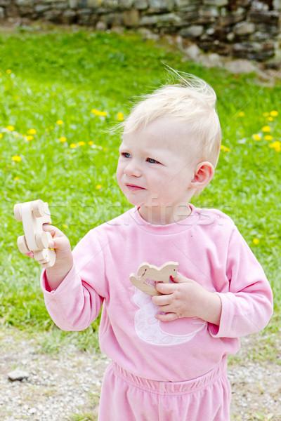Little girl jogar brinquedos menina criança Foto stock © phbcz
