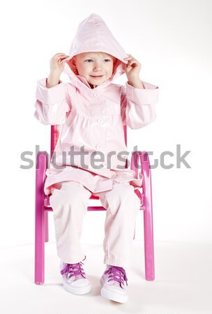Kislány visel esőkabát divat gyermek rózsaszín Stock fotó © phbcz