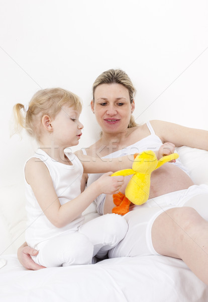 Little girl grávida mãe brinquedo bebê amor Foto stock © phbcz