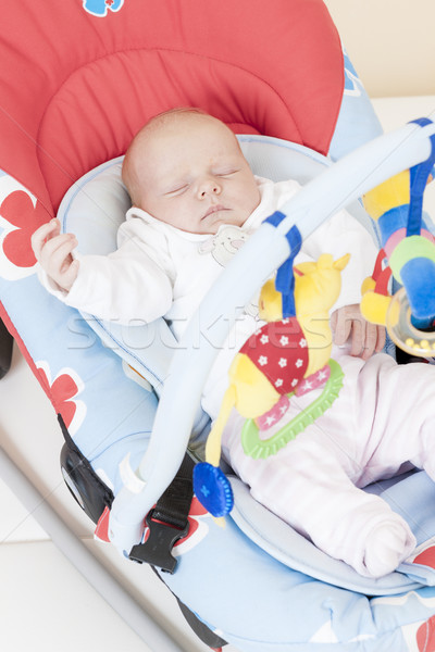 one month old baby girl sleeping in baby''s chair Stock photo © phbcz