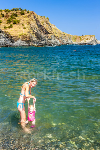 mother with her daughter in Mediterranean Sea, France Stock photo © phbcz