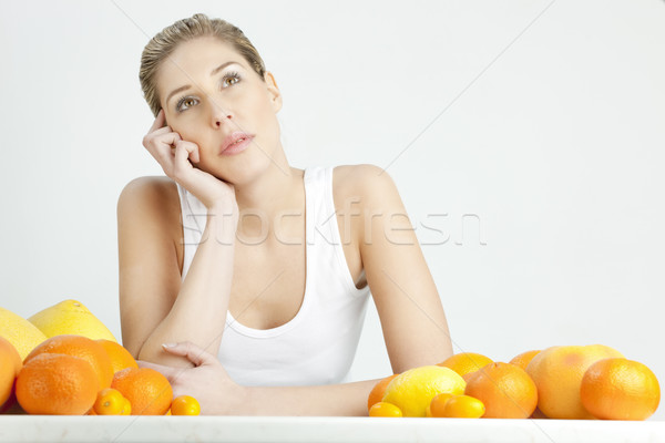 portrait of young woman with citrus fruit Stock photo © phbcz