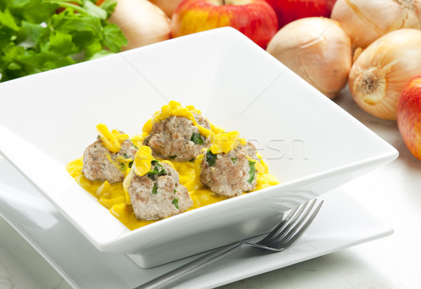 minced meat and herbs balls in apple and curry sauce Stock photo © phbcz