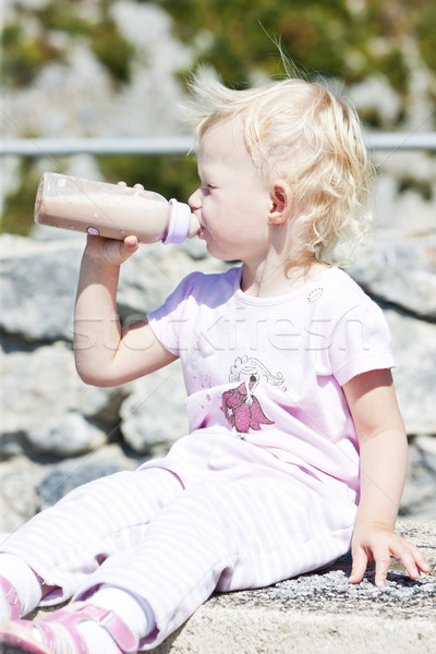 little girl with a bottle of milk Stock photo © phbcz