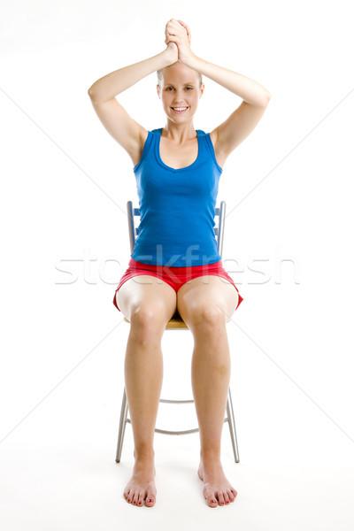 Mulher sessão cadeira fitness esportes Foto stock © phbcz