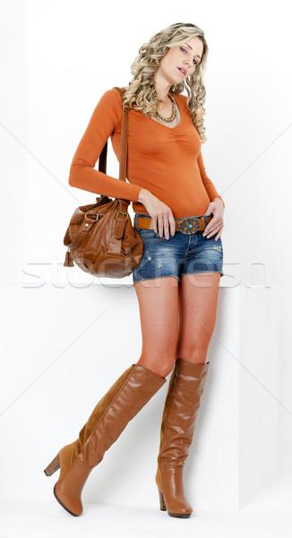 áll nő visel divatos barna csizma Stock fotó © phbcz