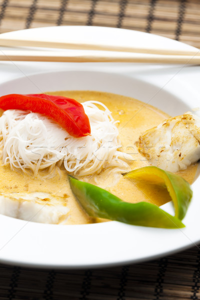 Thai curry with cod and rice noodles Stock photo © phbcz