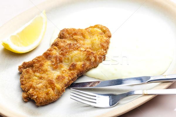 Sült disznóhús steak tányér kés citrom Stock fotó © phbcz