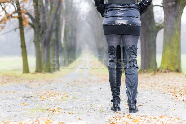detail of woman wearing black clothes and boots in autumnal alle Stock photo © phbcz