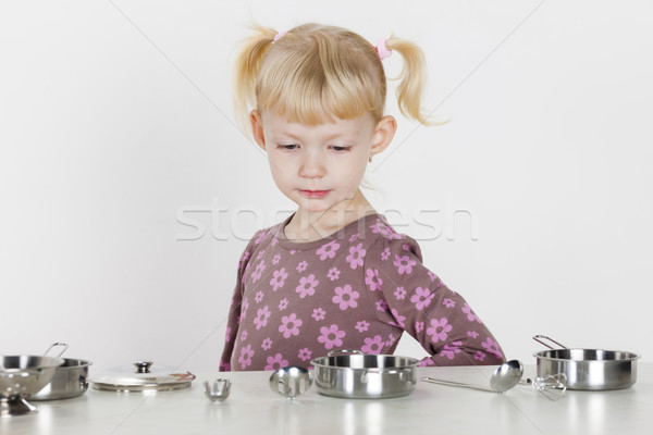 little girl playing with child dish Stock photo © phbcz