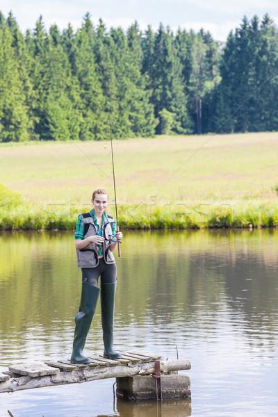 Młoda kobieta połowów molo staw kobiet relaks Zdjęcia stock © phbcz